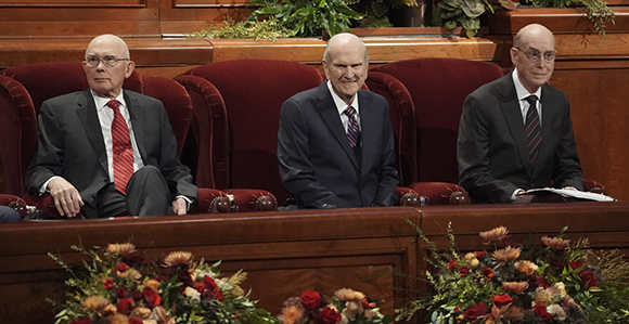 President Russell M. Nelson (center) sits with fellow members of the First Presidency, President Oaks (left) and President Eyring (right) during the Saturday morning session of General Conference, October 5, 2019.