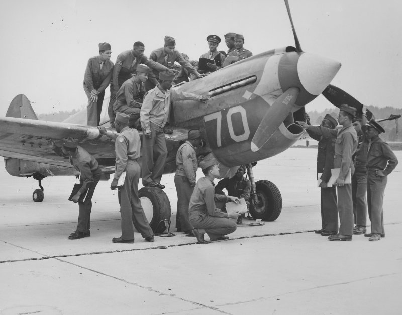 Tuskegee Airmen, with fighter airplane, at Tuskegee Army Flying School during World War 2, Tuskegee, Alabama, 1944. (Photo by Afro American Newspapers/Gado/Getty Images)